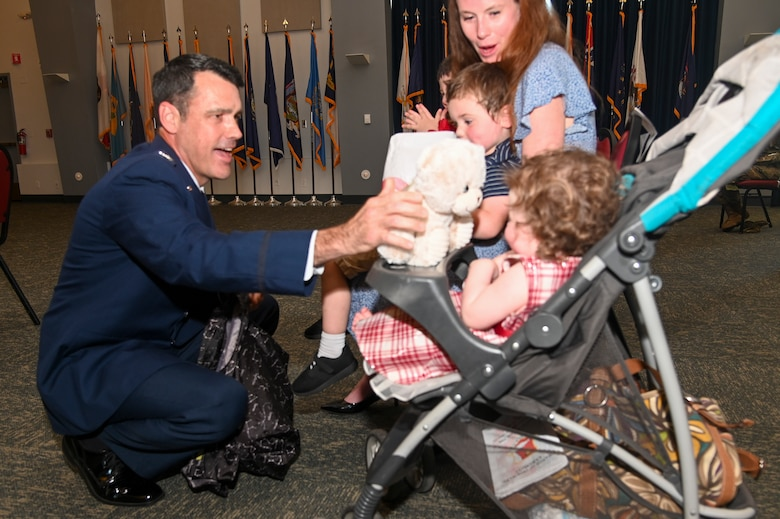 Col. Erik Aufderheide, 940th Air Refueling Wing commander, gives his family gifts during a change of command ceremony June 12, 2021, at Beale Air Force Base, California.