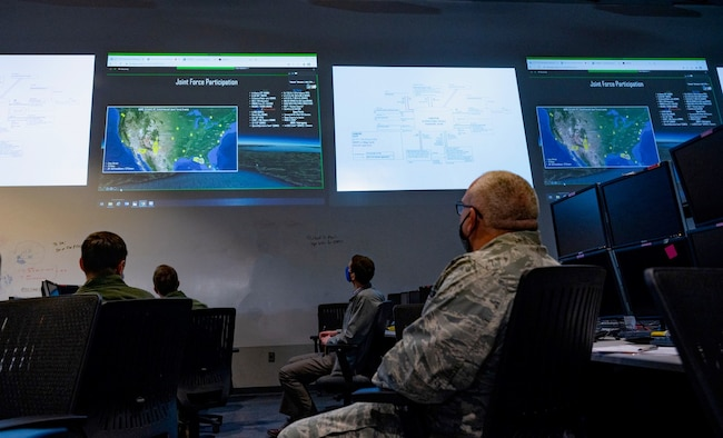 Warfighters at Nellis Air Force Base, Nev., are briefed on the capabilities of the Advanced Battle Management System at the Shadow Operations Center-Nellis, Feb. 26, 2021. The ShOC-N has been tasked by the Joint Chiefs of Staff to become the Air Force's Joint All-Domain battle laboratory for information gathering and dissemination and application testing and development in order to further enable the Air Force's ABMS mission. Photo edited for security purposes. (U.S. Air Force photo by Airman 1st Class Zachary Rufus)
