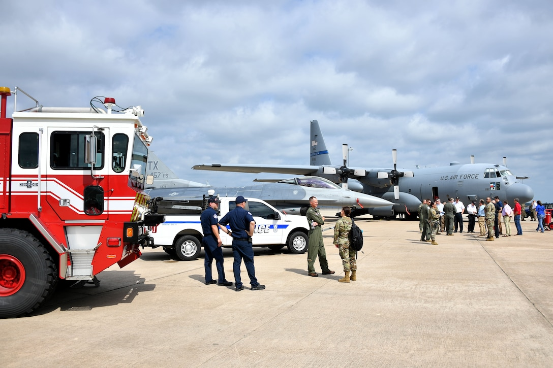 Civic leaders from the Dallas/Fort Worth area tour the designated Air Force portion of flight line during the Civic Leader Day Event held June 11, 2021, at U.S. Naval Air Station Joint Reserve Base Fort Worth, Texas. This location highlighted base fire department and 301 FW Security Forces, while featuring the 301 FW and the Texas Air National Guard 136th Airlift Wing, which personified total force integration in order to get the mission accomplished. (U.S. Air Force photo by Staff Sgt. Randall Moose)