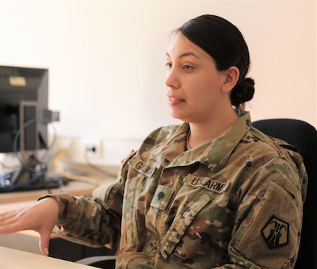 Spc. Briggany Galicia-Reyes, a bio-medical equipment technician with the Medical Support Unit Europe, talks about her experience with the medical support forward team during a medical command post exercise, part of Defender Europe 21, on Daenner Kaserne in Kaiserslautern, Germany June 11, 2021. Defender Europe 21 is an annual large-scale U.S. Army Europe and Africa-led joint, multinational exercise designed to build readiness and interoperability between U.S., NATO and partner militaries.  (U.S. Army photo by Sgt. Christopher Stelter)