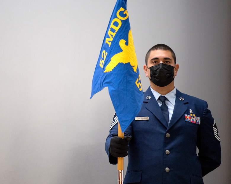 Guidon bearer holds the 52nd Dental Squadron guidon during the 52nd DS deactivation ceremony.