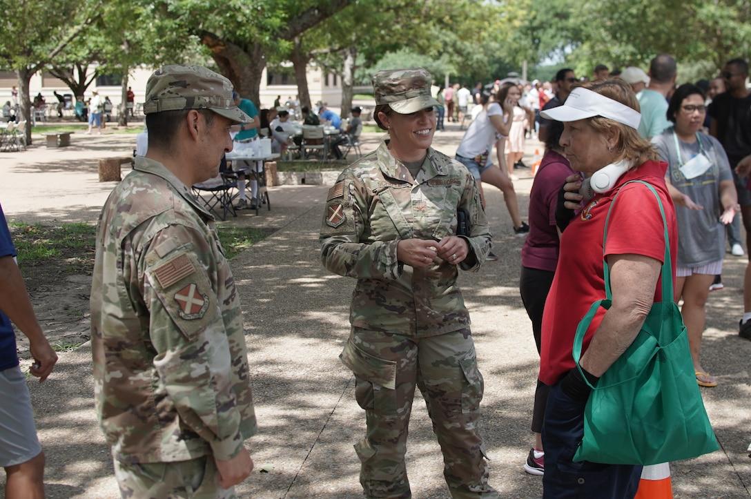 Col. Gillis, Col. Schafer and Ms. Boaldin at AMIGO picnic.