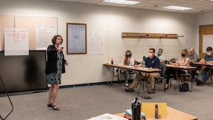 Instructor teaching emotional intelligence course.