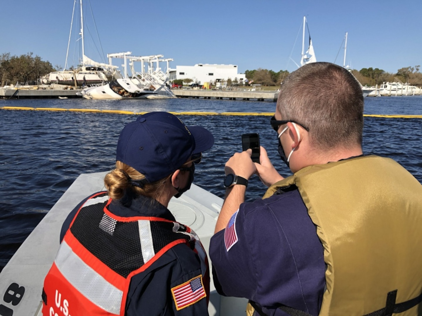 Coast Guard Petty Officer 1st Class Alysha Nagel, and Petty Officer 2nd Class Garrett Ragland conduct post Hurricane Sally assessments to determine environmental threats posed by vessels, in Perdido Bay in Lillian, Alabama, Oct. 3, 2020. Marine Environmental Response teams validated vessel statuses from initial data collected immediately following the hurricane. U.S. Coast Guard photo by Chief Petty Officer Melissa Leake.