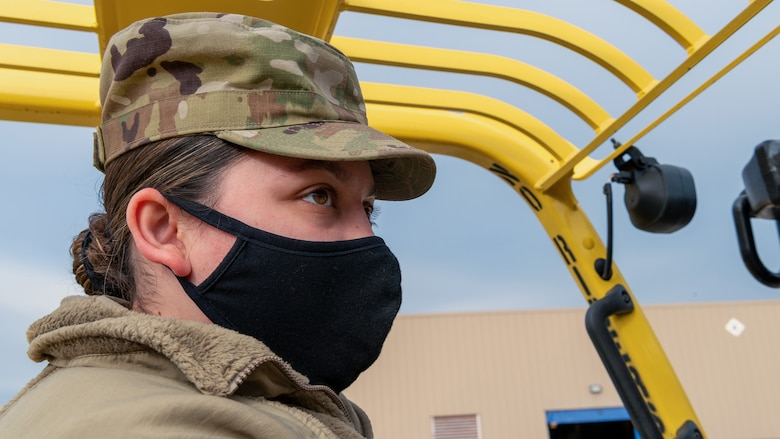 Airman driving forklift.