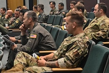 pilots sit in theater for briefing