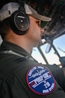 pilot conducts in-flight operation