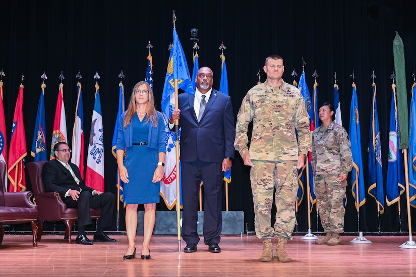 Donna Fontes, 733rd Force Support Squadron director, and U.S. Army Col. Chesley Thigpen, 733rd Mission Support Group commander, pose for a picture at Joint-Base Langley-Eustis, Virginia, June 15, 2021. During a 733rd Squadron Activation ceremony, the 733rd FSS was officially activated to provide streamlined support for mission partners at JBLE.  (U.S. Air Force photo by Senior Airman John Foister)
