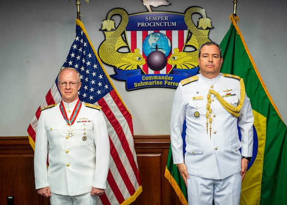 Vice Adm. Daryl Caudle, commander, U.S. Submarine Forces (SUBFOR), left, and Vice Adm. Amaury Calheiros, Brazilian Naval Attaché, participate in an award ceremony at SUBFOR Headquarters, June 14, 2021.