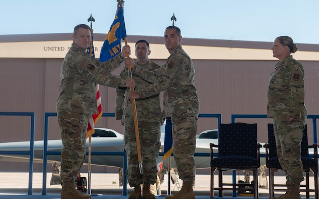 U.S. Air Force Maj. Robby Gallegos assumes command of the 509th Aircraft Maintenance Squadron  at Whiteman Air Force Base, Missouri, June 14, 2021. A change of command is a military tradition that represents a formal transfer of authority and responsibility for a unit from one commanding officer to another.