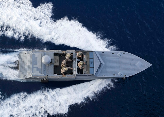 """A combatant craft assault craft assigned to Special Boat Team twenty steams alongside the Expeditionary Sea Base USS Hershel """"Woody"""" Williams (ESB 4) in the Mediterranean Sea, May 26."""