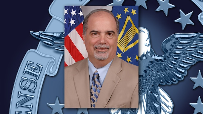 A portrait of Anthony Poleo on a background featuring a portion of the DLA emblem