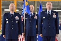 Col. Tyler Schaff, 316th Wing and installation commander, left, Col. John Ross, 316th Operations Group commander, right, and Chief Master Sgt. Harold Kruger, 316th Operations Group superintendent, stand at attention during a change of command ceremony June 10, 2021, at Joint Base Andrews, Md. Organizational flags were developed with color arrangements and symbols unique to each particular unit. A change of command is a military tradition that represents a formal transfer of authority and responsibility for a unit from one commander to another. (U.S. Air Force photo by Senior Airman Daniel Brosam)