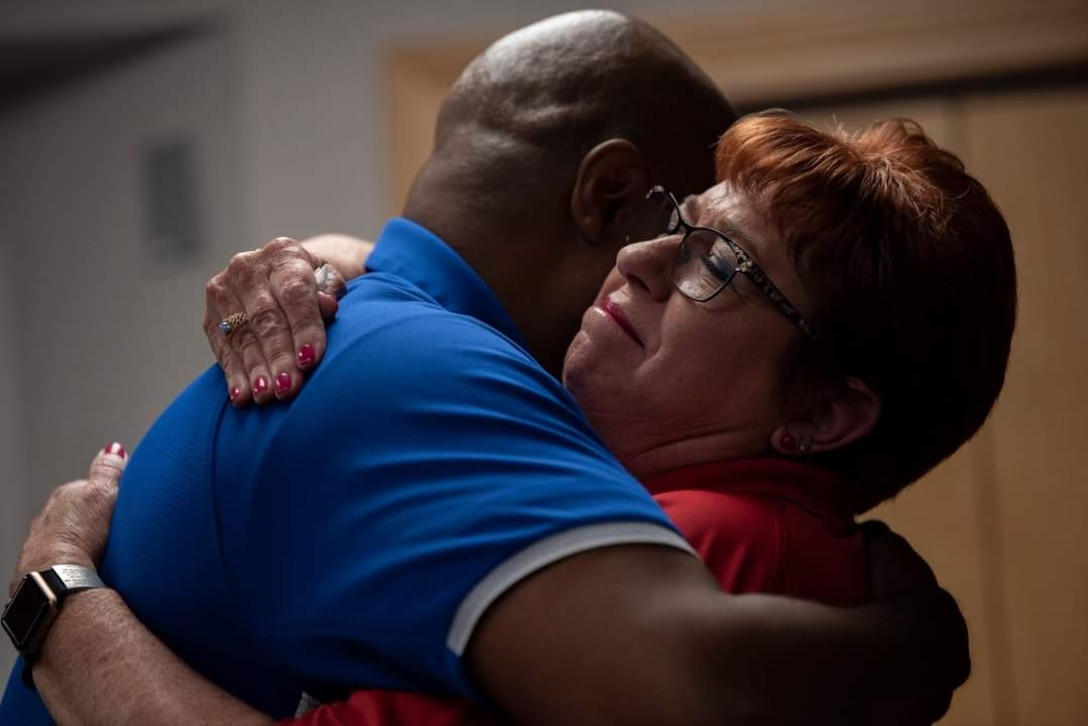 """Master Sgt. (ret) Jonathan Session, hugs his Recovery Care Coordinator, Debra Morotini, at Dyess Air Force Base, Texas on June 7, 2021. Mrs. Morotini helped Jonathan get his military pay and Tricare benefits fixed once he was not authorized to retire on his original date. This issue caused a lot of stress for Jonathan and his family. He now refers to Mrs. Morotini as his """"angel."""" (U.S. Air Force photo by A1C Colin Hollowell)"""