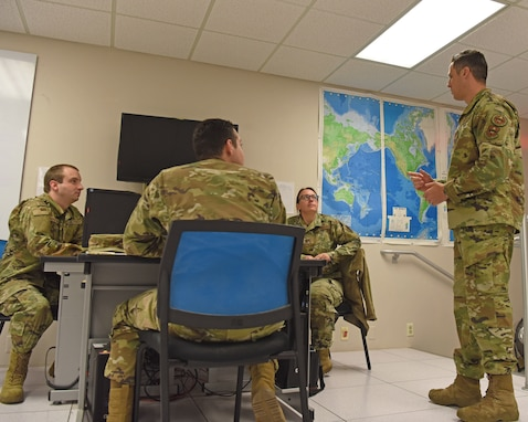 U.S. Air Force Capt. Tyler Sumrall, 315th TRS instructor, talks with students in the 14N Intelligence Officer course, on Goodfellow Air Force Base, Texas, June 6, 2021.  Goodfellow has unique partnerships with approved universities, which allow 14N course graduates to transfer 12-15 credit hours towards approved graduate level programs. (U.S. Air Force photo by Senior Airman Abbey Rieves) *NOTE: This photo has been edited to distort computer classification markers.