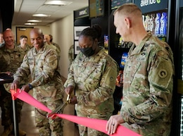 Soldiers cut ribbon and open micor market