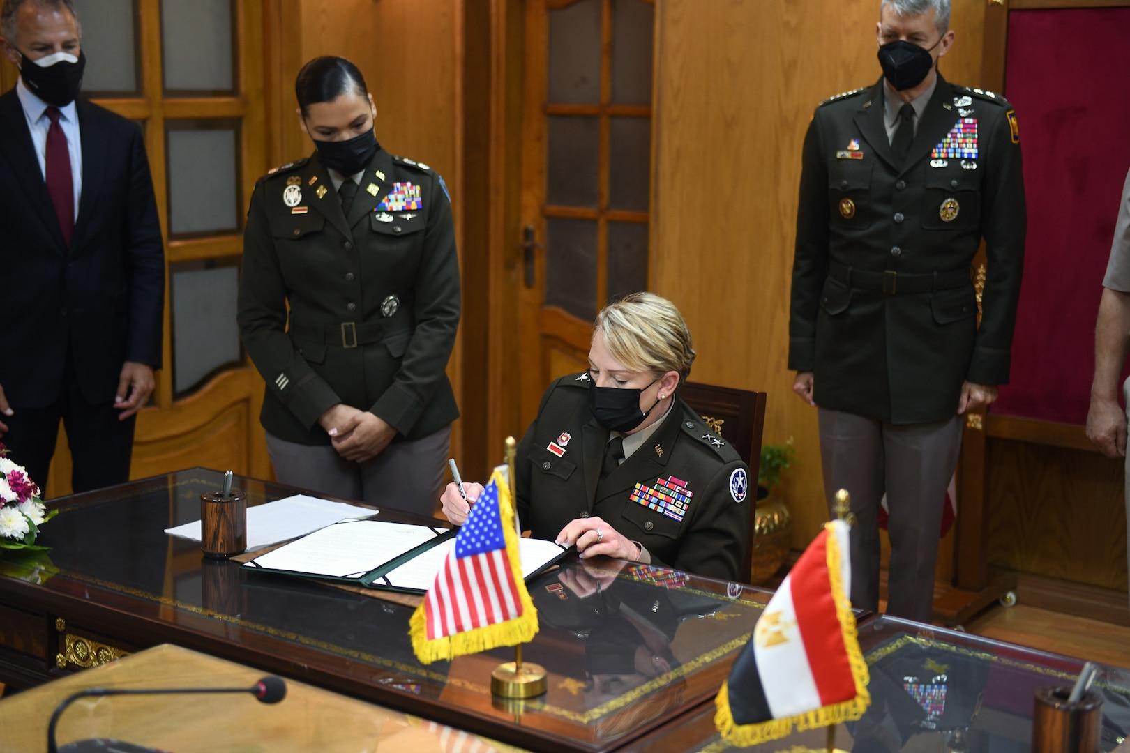 Army Maj. Gen. Tracy Norris, adjutant general, Texas National Guard, signs a document formalizing the pairing of Egypt and the Texas National Guard in the Department of Defense National Guard State Partnership Program, Cairo, Egypt, June 14, 2021.