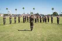U.S. Marine Corps Staff Sgt. John Geary conducts the 3rd Marine Aircraft Wing Band during a change of command ceremony on Marine Corps Air Station Yuma, June 8, 2021. The ceremony marks a change in leadership and the continuation of the unit's effectiveness. (U.S. Marine Corps photo by Lance Cpl. Carlos Kealy)