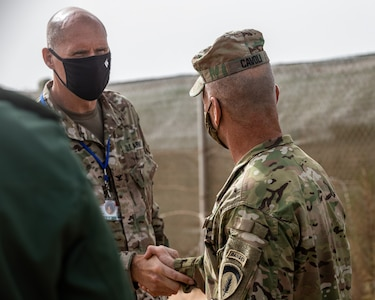 General Christopher G. Cavoli meets with Col. Paul Peters commander of the 19th Special Forces Group (Airborne) at Camp Tifnit Training Area, Morocco, Africa during the annual Africa Lion Exercise on June 9, 2021