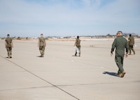 U.S. Marine Corps Capt. Richard Hetrick, an aviation safety officer with Headquarters and Headquarters Squadron, oversees Marines conducting Foreign Object Debris (FOD) walk at Marine Corps Air Station Yuma, Ariz., June 7, 2021.  A FOD walk is conducted routinely to make sure runways are clear from debris that may damage aircraft using it. (U.S. Marine Corps Photo by Lance Cpl Matthew Romonoyske-Bean)