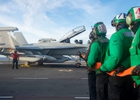 Sailors fight a simulated fire on the flight deck of the Nimitz-class aircraft carrier USS Harry S. Truman (CVN 75) during Tailored Ship's Training Availability (TSTA) and Final Evaluation Problem (FEP).