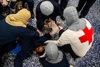 Sailors treat a simulated personnel casualty on the aft mess decks during a general quarters training evolution aboard the Nimitz-class aircraft carrier USS Harry S. Truman (CVN 75) during Tailored Ship's Training Availability (TSTA) and Final Evaluation Problem (FEP).