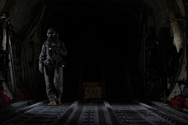 Staff Sgt. Tristan Geray, 40th Airlift Squadron loadmaster, conducts preflight checks in the cargo bay of a C-130J Super Hercules at Dyess Air Force Base, Texas, June 3, 2021. Geray participated in the field testing of the new Uniform Integrated Protective Ensemble Air 2 Piece Under Garment chemical, biological, radioactive and nuclear protective equipment.