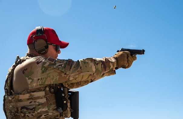 Staff Sgt. John Brown, 152nd Security Forces Squadron combat arms training and maintenance instructor, fires an M9 handgun during a live-fire training exercise at the Hawthorne Army Depot Freedom Range, Hawthorne, Nev., June 10, 2021. The instructors lead, manage, supervise and implement small arms weapons training programs.