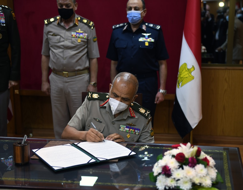 The Arab Republic of Egypt's Assistant Minister of Defense for International Affairs, Maj. Gen. Mohamed Salah signs a document formalizing the pairing of Egypt and the Texas National Guard in the Department of Defense National Guard State Partnership Program, Cairo, Egypt, June 14, 2021.