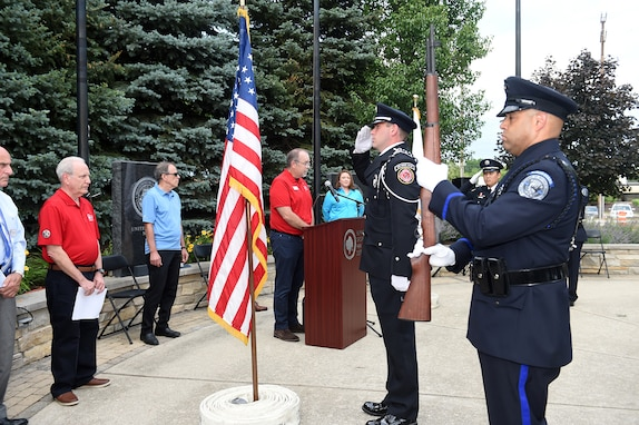 The Buffalo Grove honor guard detail, made up of police officers and fire-fighters from Buffalo Grove, render a salute during a presentation of Colors at the Village of Buffalo Grove annual Flag Day commemoration, June 14, 2021.