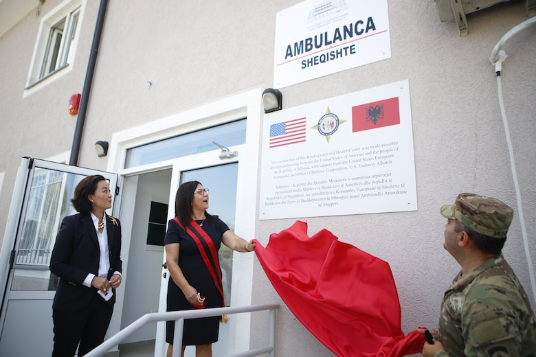 U.S. Ambassador to Albania Yuri Kim looks on as Patos Mayor Rajmonda Balilaj and Chief of the Office of Defense Cooperation at the U.S. Embassy in Tirana Lt. Col. Erol Munir, unveil signage at a ceremony at the two-story kindergarten and health clinic facility in September 2020 where the U.S. Army Corps of Engineers recently completed a major renovation project. The project is a recent example of the kind of humanitarian assistance work the U.S. Army Corps of Engineers does in Albania in close partnership with the U.S. European Command and the U.S. Embassy in Tirana, Albania's capital. The U.S. Army Corps of Engineers is actively managing several additional projects involving either the construction of new facilities or the renovation of existing facilities to help improve services Albania can provide to its youngest, oldest and most vulnerable citizens.