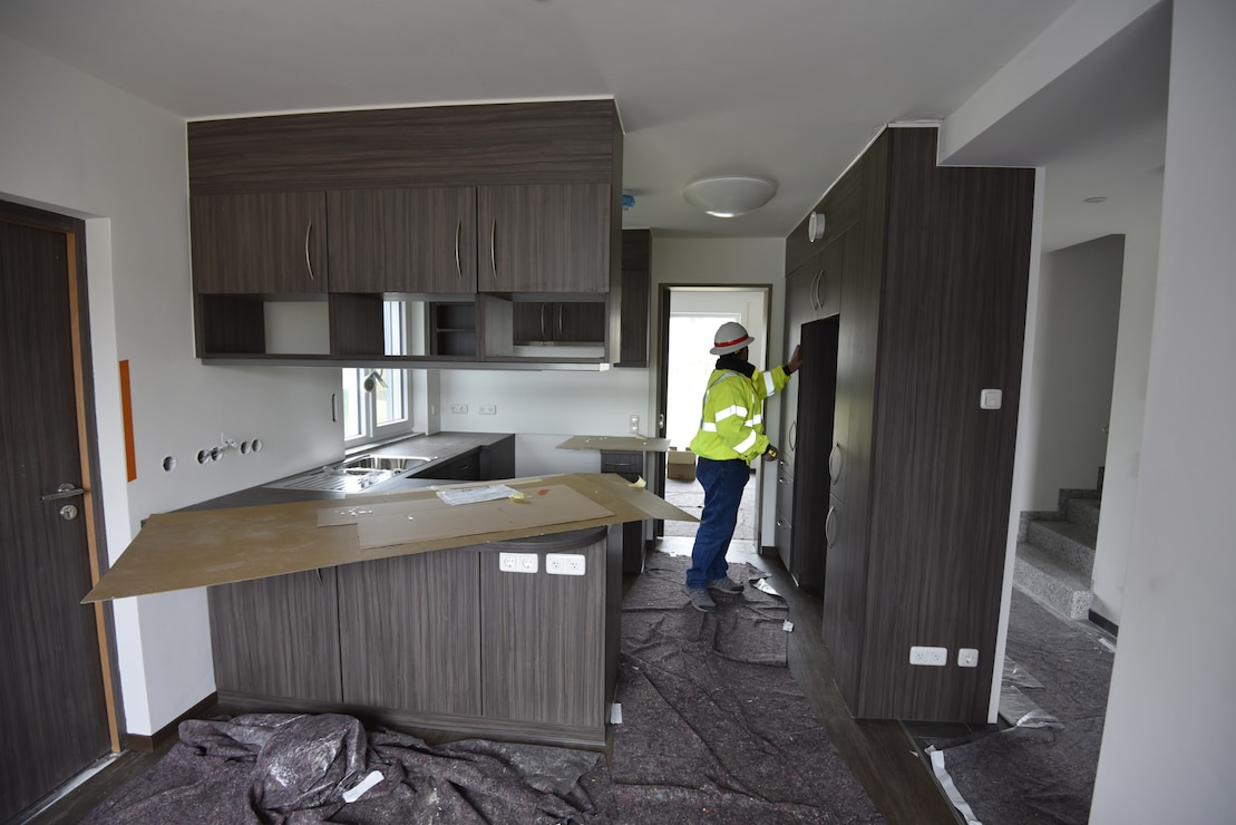U.S. Army Corps of Engineers, Europe District Project Engineer John Taylor checks out progress on the installation of a kitchen in a nearly completed home May 6, 2021 in the Kittenberg Housing Area on Rose Barracks in Vilseck, Germany, which is part of U.S. Army Garrison Bavaria. The family home is one of 29 in a newly built neighborhood the U.S. Army Corps of Engineers is turning over to the garrison for Soldiers and their families. The homes are part of a larger, long-term collaboration between the U.S. Army Corps of Engineers and the garrison to provide new and renovated family housing and other quality of life projects for Soldiers and their families at Rose Barracks.