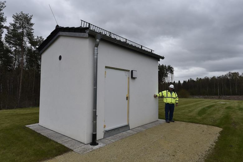 U.S. Army Corps of Engineers, Europe District Project Engineer John Taylor points out a shared utility building that serves several newly constructed homes May 6, 2021 in the Kittenberg Housing Area on Rose Barracks in Vilseck, Germany, which is part of U.S. Army Garrison Bavaria. The U.S. Army Corps of Engineers is delivering 29 family homes, including associated infrastructure like drainage, utilities and roads in a newly built neighborhood for Soldiers and their families. The homes are part of a larger, long-term collaboration between the U.S. Army Corps of Engineers and the garrison to provide new and renovated family housing and other quality of life projects for Soldiers and their families at Rose Barracks.