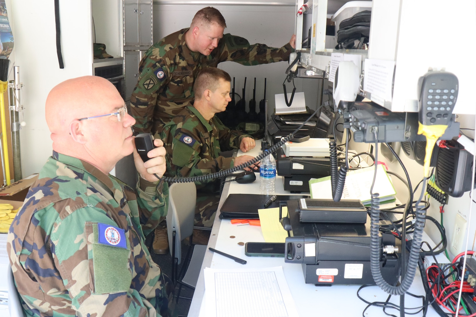 Virginia Defense Force personnel assigned to the Communication Battalion, Support Operations Group relay message traffic in a Mobile Communication Platform June 5, 2021, in Lynchburg, Virginia.