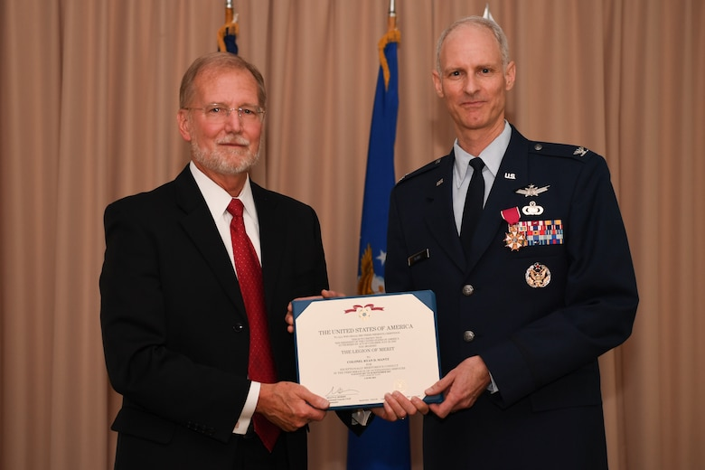 Steven Wert, program executive office Digital, headquartered at Hanscom Air Force Base, Mass., presents Col. Ryan Mantz with the Legion of Merit during his retirement ceremony June 11. Mantz, who had served as the deputy program executive officer for Digital since August 2017, retired after 29 years of service.