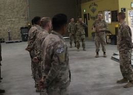 Commanding General of 1st Theater Sustainment Command, Maj. Gen. John P. Sullivan, speaks to riggers of the Fort Bragg, N.C., based 151st Quartermaster Detachment, during his June 10, 2021 visit to the Eric T. Burri U.S. Army Rigging Facility at Al Udeid Air Base, Qatar. The general told the riggers that their contributions to sustainment operations in the field were relied on and appreciated.