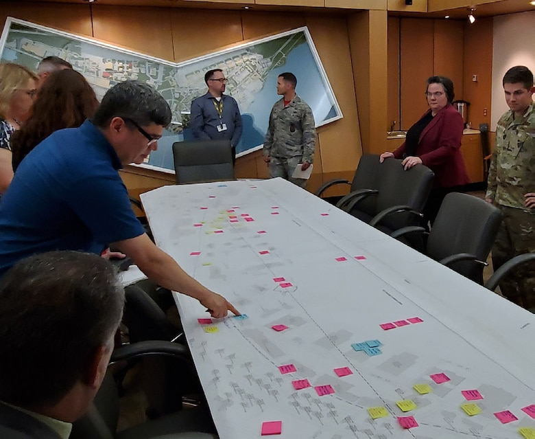 Officials from Joint Base Langley-Eustis review the area development plan during the 43rd Formal Training Unit Bed down charrette in 2019. Planning and Programming Support Branch received national award their plan during the American Planning Associations 2021 National Federal Planning Division Conference.