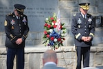 U.S. Army Maj. Gen. Thomas Carden (right), The Adjutant General of Georgia, and Command Sgt. Maj. Jeff Logan (left), the state command sergeant major of the Georgia Army National Guard, bow their heads in prayer May 27, 2021, during a Memorial Day Observation Ceremony at Clay National Guard Center in Marietta, Georgia. The Georgia National Guard memorial wall is dedicated to the memory of 43 Georgia Army National Guard Soldiers who have fallen since September 11, 2001. (U.S. Army National Guard photo by Capt. Bryant Wine)
