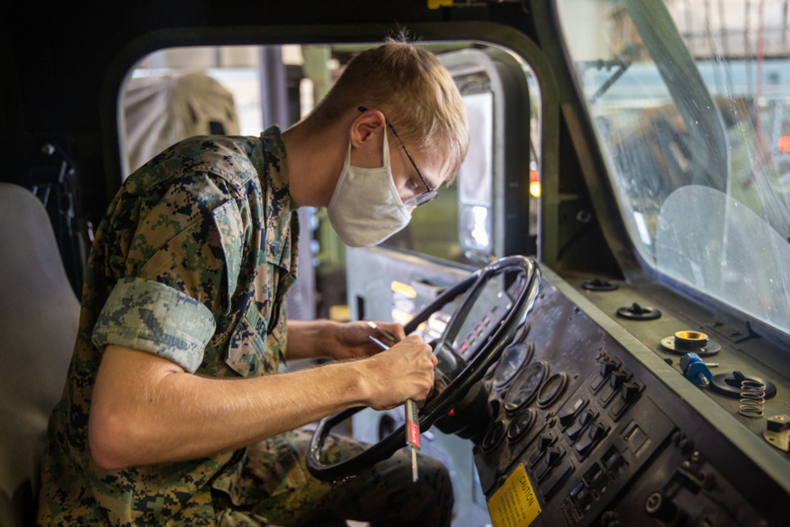 Cpl. Aiden Bemis, a digital manufacturing engineer with 1st Supply Battalion, 1st Marine Logistics Group, I Marine Expeditionary Force, measures the width of a steering wheel column at Marine Corps Base Camp Pendleton, April 29, 2021. Bemis provided the capability to mass produce a steering wheel remover tool that prevents damage to the steering wheel column during removal. The tool was originally designed by Staff Sgt. Kyle Owens, a motor transportation chief with Combat Logistics Battalion 5, 1st MLG. In 2012, after cracking multiple steering wheel columns using a slide hammer kit, he came up with the idea to drill three holes into a standard washer and weld a nut so that he could effectively remove a steering wheel from the Medium Tactical Vehicle Replacements and Logistics Vehicle System Replacements.