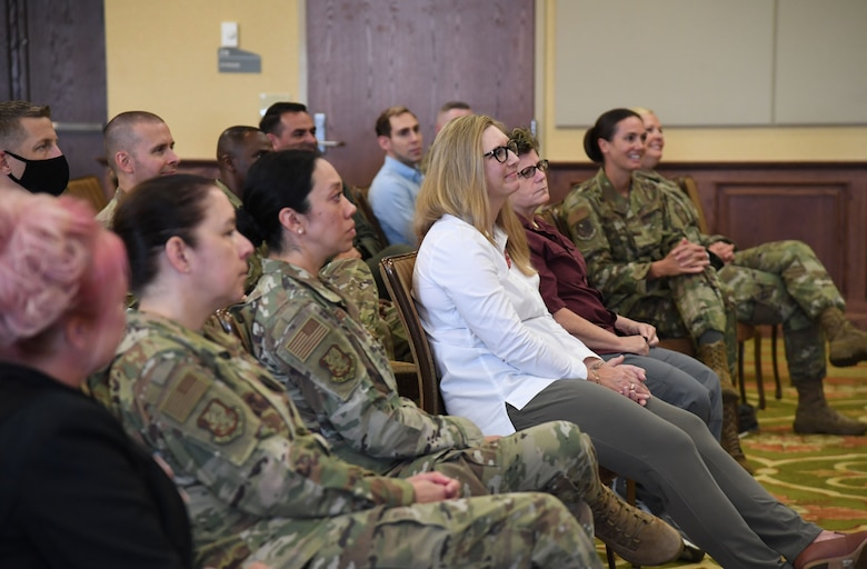 Keesler personnel attend a Pride Month speaking event inside the Bay Breeze Event Center at Keesler Air Force Base, Mississippi, June 15, 2021. Keesler celebrates Pride Month throughout June, with events such as a scavenger hunt, discussion panel and a LGBTQ+ informational expo. (U.S. Air Force photo by Kemberly Groue)