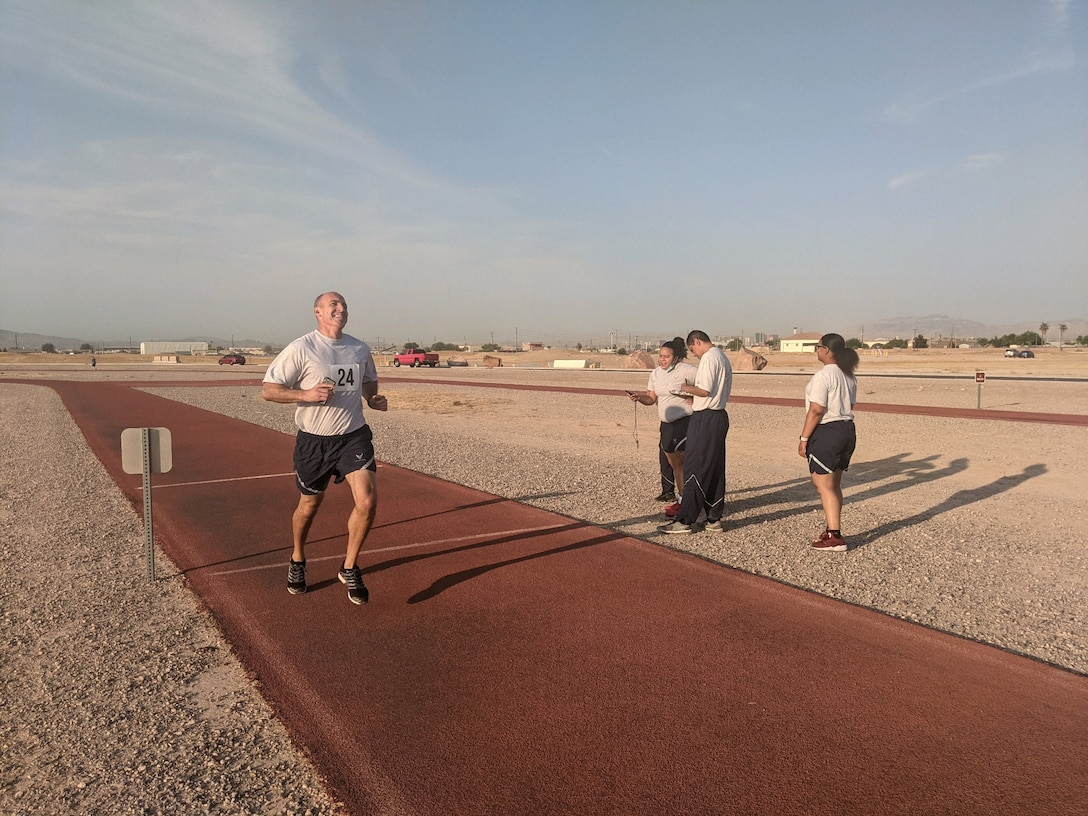 Maj. Mike Giaquinto, 926th Wing Public Affairs officer, performs a diagnostic physical fitness test, June 15, at Nellis Air Force Base, Nevada. (U.S. Air Force by Dan Mena)