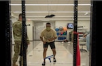 Airman 1st Class Kameron Burton-Reeder, 502nd Comptroller Squadron budgeting and accounting technician, does monster walks in the Physical Therapy Clinic at Wilford Hall Ambulatory Surgical Center, Joint Base San Antonio-Lackland, Texas, June 8, 2021. June is National Men's Health month to heighten awareness of preventable health problems and encourage early detection and treatment of disease. (U.S. Air Force photo by Airman 1st Class Melody Bordeaux)