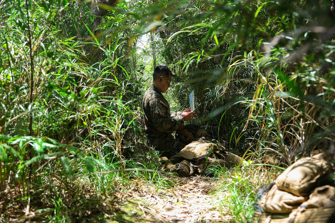 U.S. Marine Corps Staff Sgt. Tyler Ochs, a platoon commander with 1st Battalion, 6th Marine Regiment, currently attached to 3rd Marine Division under the Unit Deployment Program, sets up defensive positions during an Expeditionary Advance Base Operation exercise at the Northern Training Area, Okinawa, Japan, June 17, 2020. This 1st Battalion, 6th Marine Regiment-led exercise also features participation from 3rd Reconnaissance Battalion and High Mobility Artillery Rocket Systems from 3rd Battalion, 12th Marine Regiment. Training events like this strengthen 3rd Marine Division's ability to control key terrain in a contested battlespace. Ochs is a native of Fond du Lac, Wisconsin