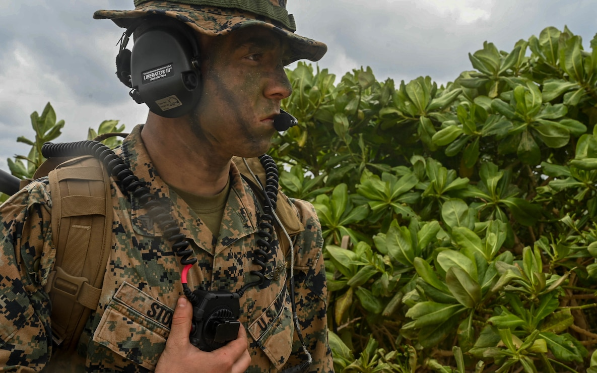 A U.S. Marine with Marine Air Control Squadron 4 establishes communications during exercise Hagåtña Fury 21  on Ukibaru, Japan, Feb 18, 2021. The exercise demonstrated that Marines are capable of seizing, defending, and providing expeditionary sustainment for key maritime terrain in support of the III Marine Expeditionary Force. 3/8 is attached to 3d Marine Division as a part of the unit deployment program.