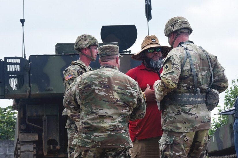 Bryan Brown talks with several leaders from 2/138th FA (Paladin)