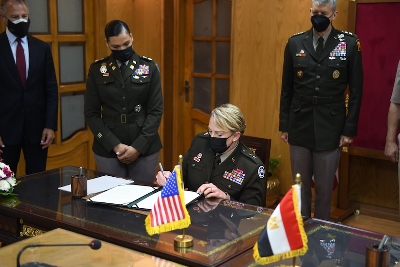 Army Maj. Gen. Tracy Norris, adjutant general, Texas National Guard, signs a document formalizing the pairing of Egypt and the Texas National Guard in the Department of Defense National Guard State Partnership Program, Cairo, Egypt, June 14, 2021. (U.S. Army National Guard photo by Master Sgt. Jim Greenhill)