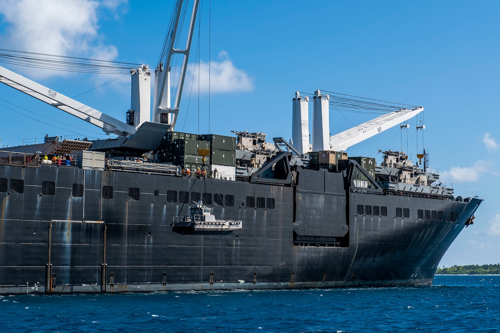 DIEGO GARCIA, British Indian Ocean Territory (November 11, 2019) Sailors lower a maritime prepositioning force utility boat from Military Sealift Command Bob Hope-class roll-on roll-off vehicle cargo ship USNS Seay (T-AKR 302) using a crane during an Improved Navy Lighterage System (INLS) training mission. Navy Cargo Handling Battalion (NCHB) 1, NCHB 8, NCHB 11, NCHB 13, Assault Craft Unit (ACU) 1 and Amphibious Construction Battalion (ACB) 1 are participating in the INLS training mission under the direction of Commander, Task Force (CTF) 75 in preparation for upcoming joint cargo handling exercise Native Fury 2020. (U.S. Navy photo by Mass Communication Specialist 1st Class Nathan Carpenter)