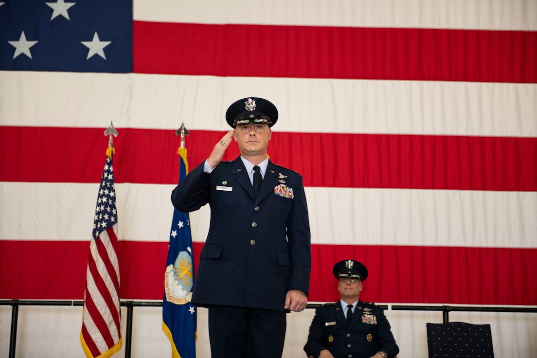 U.S. Air Force Col. Daniel Diehl, 509th Bomb Wing commander, renders his first salute to the unit during the 509th BW change of command ceremony, Whiteman Air Force Base, Missouri, June 16, 2021. Over the past months, Diehl has trained and qualified in the stealth bomber and over the next couple of weeks will meet with representatives of each group on base to immerse himself in Team Whiteman's wide-ranging missions and community. (U.S. Air Force photo by Airman First Class Victoria Hommel)