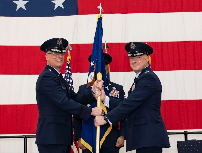 U.S. Air Force Maj. Gen. Mark Weatherington, Eighth Air Force and Commander Joint-Global Strike Operations Center, passes the unit flag to Col. Daniel Diehl, in-coming 509th Bomb Wing commander, during the 509th BW change of command ceremony, Whiteman Air Force Base, Missouri, June 16, 2021. Diehl transitioned to Whiteman AFB from Dyess AFB, Texas, where he commanded the 7th Operations Group -- Air Force Global Strike Command's largest B-1 bomb group. At Whiteman, Diehl will be responsible for the combat readiness of the Air Force's only B-2 Spirit wing and supporting installation functions. (U.S. Air Force photo by Airman First Class Victoria Hommel)