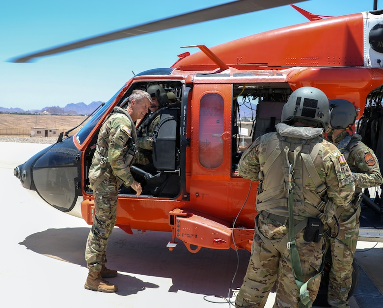 Army Gen. Daniel Hokanson, chief, National Guard Bureau, talks with troops after taking an aerial familiarization tour of the Multinational Force and Observers mission on the Arab Republic of Egypt's Sinai Peninsula, June 15, 2021.
